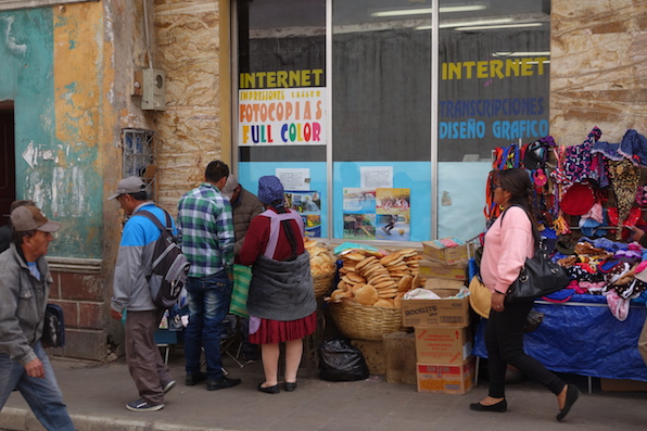 Bread is sold on the street. it's generally flat bread made from quinoa or maize. We love this photo as it's such a typical Bolivian street scene.