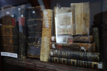 The small library had some od texts in glass cases. No touching!