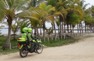 The Police in Colombia travel 2 up on small bikes.